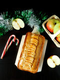 Apple cake with spices. Apple cake decorated with apple pieces surrounded by decorations royalty free stock photo