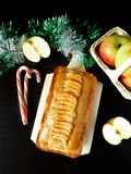 Apple cake with spices. Apple cake decorated with apple pieces surrounded by decorations stock photos