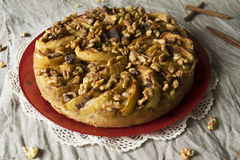 Apple cake with walnuts. Sponge cake with caramelized apples and walnuts Stock Photos