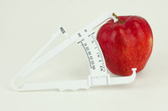 Apple With Caliper Stock Photo