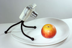 Apple and camera. Apple and digital camera with background Royalty Free Stock Photography