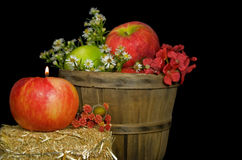 Apple candle with basket Stock Photography