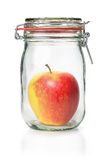 Apple in a canning jar. Fresh apple in a canning jar royalty free stock photography