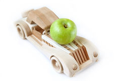 Apple and car. Green apple on the wood car Royalty Free Stock Photos