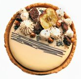 Apple and caramel cake with hazelnuts and cookie border top view. Apple and caramel nutty cake with cookie border on white background stock images