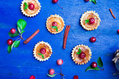 Apple caramel little tarts on blue rustic background. French tatin with paradise apple. Top view Stock Photo