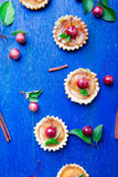 Apple caramel little tarts on blue rustic background. French tatin with paradise apple. Top view. Frame. Copy space. Stock Photo