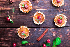 Apple caramel little tarts on brown rustic background. French tatin with paradise apple. Top view. Royalty Free Stock Image