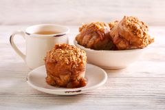 Apple and caramel muffins served. On plate stock images