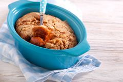 Apple and caramel pudding. In a tin stock images