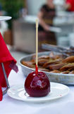 Apple in caramel on stick. Apple in caramel on wooden stick stock images