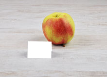 Apple and card Royalty Free Stock Photo