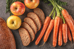 Apple and carrot bread, spelt bread with fresh vegetable and fruit, healthy food, product photography for bakery Royalty Free Stock Images