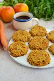 Apple carrot cookies with coffee. Homemade apple carrot oat cookies with coffee Stock Image