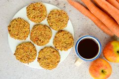 Apple carrot cookies with coffee. Homemade apple carrot oat cookies with coffee Royalty Free Stock Photography