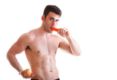 Apple carrot diet, man great body Isolated Royalty Free Stock Photography