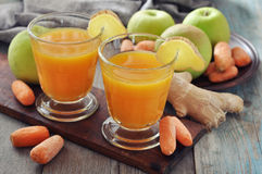 Apple and carrot juice with ginger Stock Photos