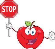 Apple Cartoon Mascot Character Holding A Stop Sign Stock Images