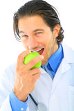 apple caucasian doctor eating green Στοκ Φωτογραφία