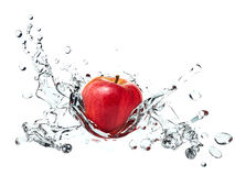 Apple causing water splash. A red apple causing water splash in all directions Stock Images