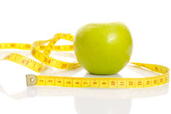An apple with centimeter. Royalty Free Stock Image