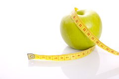 An apple with centimeter. Royalty Free Stock Images