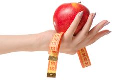 Apple centimeter in hand health losing weight. On white background isolation Royalty Free Stock Images