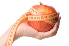 Apple centimeter in hand health losing weight. On white background isolation Stock Photography