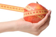 Apple centimeter in hand health losing weight. On white background isolation Stock Photos