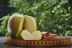 Apple and centimeter Royalty Free Stock Photography