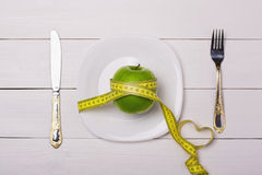 Apple and centimeter on the plate. Sport healthy food. Love Stock Image