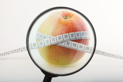 Apple with centimeter Royalty Free Stock Images