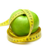 Apple with centimeter tape Royalty Free Stock Photography
