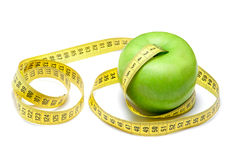 Apple with centimeter tape Stock Photos