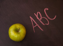 Apple  on the chalkboard. Royalty Free Stock Photography