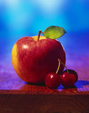 Apple and cherries Royalty Free Stock Image