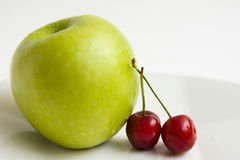 Apple and cherries Stock Photography