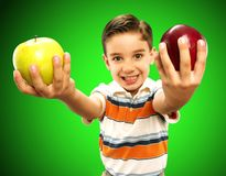 Apple child. Royalty Free Stock Photo