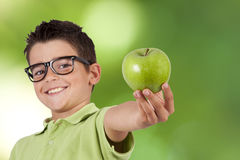 Apple. Child presenting green apple fruit royalty free stock images