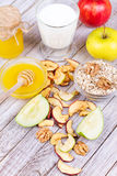 Apple Chips, Fresh Apples, Honey, Milk, Oat Flakes and Walnuts Royalty Free Stock Photos