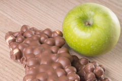 Apple and chocolate Stock Image
