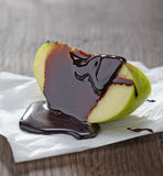 Apple with chocolate Royalty Free Stock Photos