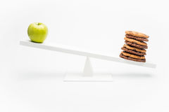 Apple and chocolate cookies on swing isolated on white Royalty Free Stock Photography