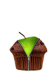 An apple in a chocolate cup cake. An apple hidden in a cup cake concept Stock Photo