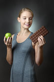 Apple or chocolate Royalty Free Stock Images