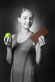 Apple or chocolate Royalty Free Stock Image