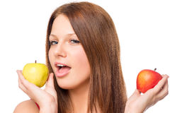 Apple choice. Woman makes a choice between apples on a white background Stock Photos