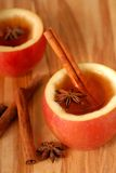 Apple cider with cinammon and star anise Stock Photos