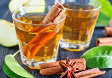 Apple cider. With cinnamon in the glass royalty free stock image