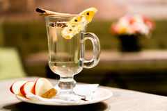 Apple cider with cinnamon stick in a glass Stock Photo